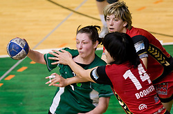 Nina Jericek of Olimpija vs Ljudmila Bodnieva and Maryna Vergeljuk of Krim at handball Slovenian cup Finals match  between RK Olimpija and RK Krim Mercator, on March 28, 2010, SD Leon Stukelj, Novo mesto, Slovenia. (Photo by Vid Ponikvar / Sportida)