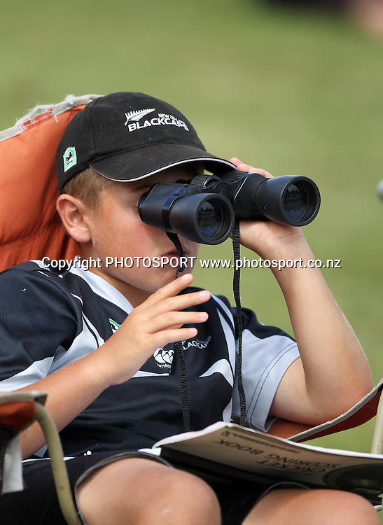 A young Black Caps fans watches the game.<br />