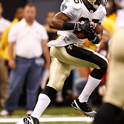 August 27, 2010; New Orleans, LA, USA; New Orleans Saints running back Reggie Bush (25) runs after catching a swing pass during the first half of a preseason game at the Louisiana Superdome. The New Orleans Saints defeated the San Diego Chargers 36-21. Mandatory Credit: Derick E. Hingle