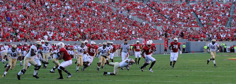 Game action at Carter Finley stadium against Western Carolina. Photo by Marc Hall