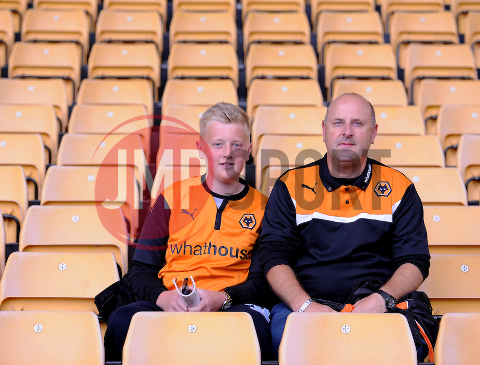 Two wolves fans pose for a photo inside the Molineux Stadium.  - Photo mandatory by-line: Alex James/JMP - Mobile: 07966 386802 10/08/2014 - SPORT - FOOTBALL - Wolverhampton - Molineux Stadium - Wolves v Norwich City - Sky Bet Championship