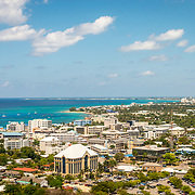 Aerial view of Grand Cayman Island arriving on George Town from airplane window.