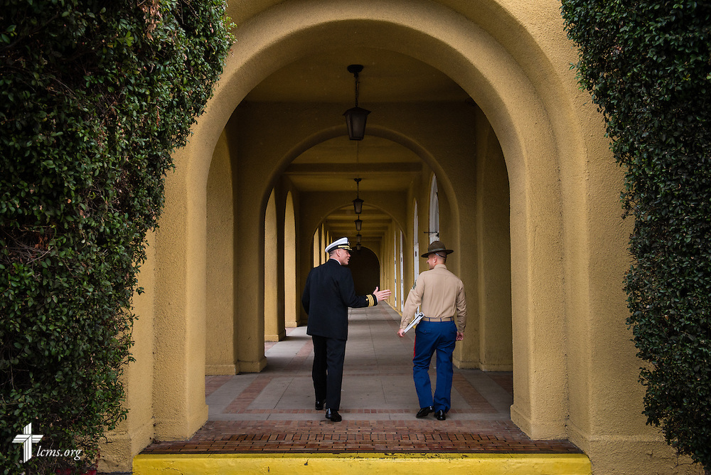 Cmdr. Charles E. Varsogea, chaplain at the Marine Corps Recruit Depot, chats with a drill instructor Friday, Jan. 30, 2015, at the depot in San Diego, Calif. LCMS Communications/Erik M. Lunsford