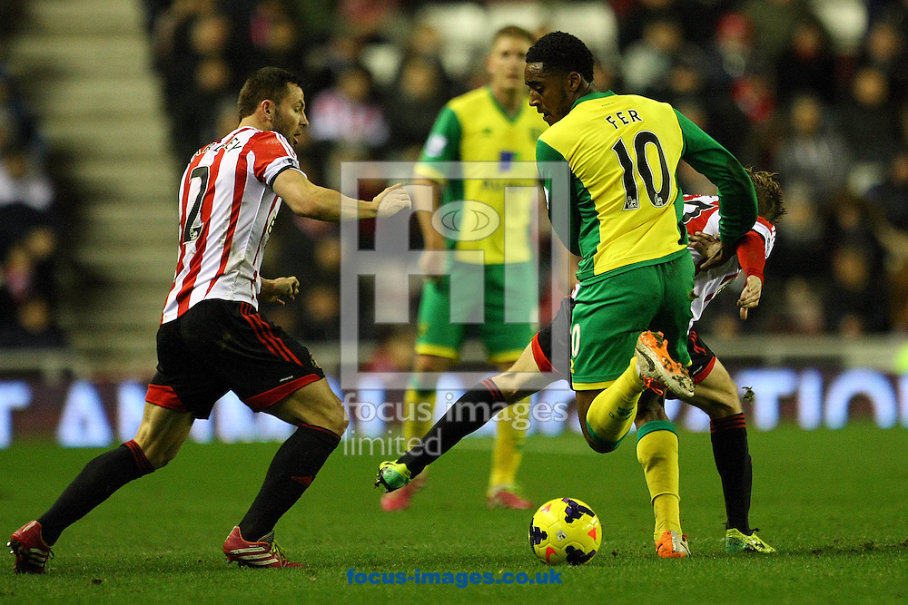 Picture by Paul Chesterton/Focus Images Ltd +44 7904 640267<br /> 21/12/2013<br /> Sunderland's Phil Bardsley and Leroy Fer of Norwich in action during the Barclays Premier League match at the Stadium Of Light, Sunderland.