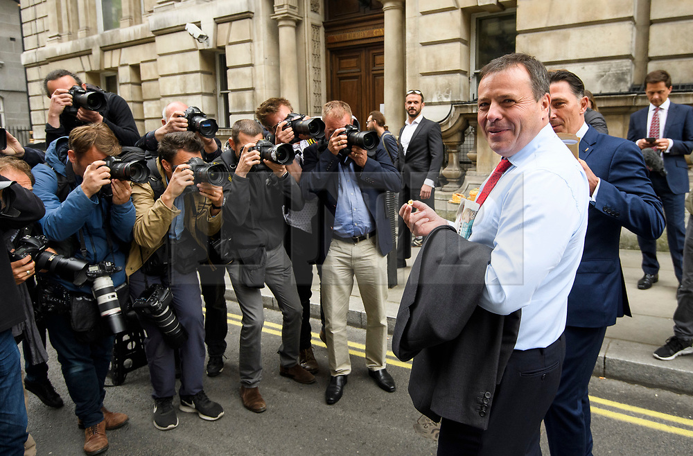 © Licensed to London News Pictures. 12/06/2018. London, UK. Media surround Leave.EU founder ARRON BANKS and Leave.EU campaigner ANDY WIGMORE as they arrive at Portcullis House in London where they are due to give evidence to a Commons Digital, Culture, Media and Sport Committee about fake news. The pair have been accused of collusion with Russian officials around the time of the Brexit referendum. Photo credit: Ben Cawthra/LNP