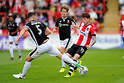 Luke Waterfall (5) of Lincoln City tackles Liam McAlinden (19) of Exeter City during the EFL Sky Bet League 2 match between Exeter City and Lincoln City at St James' Park, Exeter, England on 19 August 2017. Photo by Graham Hunt.