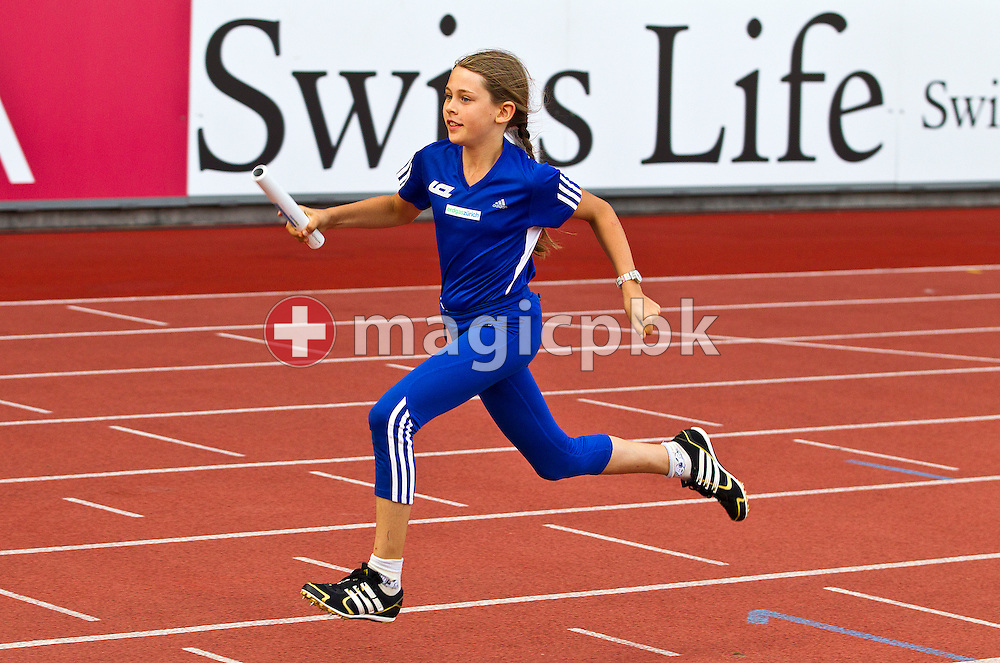A young athlete competes in the LC Zurich Relay during the IAAF Diamond League meeting at the Letzigrund Stadium in Zurich, Switzerland, Thursday, Aug. 19, 2010. (Photo by Patrick B. Kraemer / MAGICPBK)