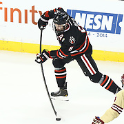Adam Reid #8 of the Northeastern Huskies shoots the puck during The Beanpot Championship Game at TD Garden on February 10, 2014 in Boston, Massachusetts. (Photo by Elan Kawesch)