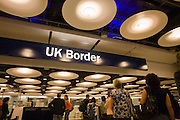 "Queues of newly-arrived airline passengers line up to await their turn at the UK Border Agency's passport control at Heathrow Airport's Terminal 5. Immigration officers deal with each member of the public seeking entry into the United Kingdom but on average, 10 a day are refused entry at this London airport and between 2008 and 2009, 33,100 people were detained at the airport for mainly passport irregularities. The UK Border Agency is responsible for securing the United Kingdom borders and controlling migration in the UK. They manage border control enforcing immigration and customs regulations and also consider applications for permission to enter or stay in the United Kingdom, citizenship and asylum. From writer Alain de Botton's book: ""A Week at the Airport: A Heathrow Diary"" (2009)."