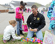 Paige Bearbower (from left), 7, Tyra Jackson, 7, and Eric Bearbower, all of Cedar Rapids, work on opening their eggs after the Easter Egg Hunt at Hillside Wesleyan Church, 2600 1st Ave NW, in Cedar Rapids on Saturday morning, March 31, 2012. This year there were over 7,500 eggs up for grabs. (Stephen Mally/Freelance)