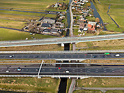 Nederland, Zuid-Holland, Gemeente Alkemade, 20-02-2012; infrastructuur bundel bestaande uit autosnelweg A4 en het hogesnelheidspoor HSL-Zuid (boven) doorkruist het veenweidelandschap tussen Roelofarendsveen en kruist de Rijpwetering. .Infrastructure bundle consisting of A4 motorway and the high-speed (top) crosses the bog meadows area between Roelofarendsveen and crosses the Rijpwetering..luchtfoto (toeslag), aerial photo (additional fee required).copyright foto/photo Siebe Swart