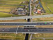 Nederland, Zuid-Holland, Gemeente Alkemade, 20-02-2012; infrastructuur bundel bestaande uit autosnelweg A4 en het hogesnelheidspoor HSL-Zuid (boven) doorkruist het veenweidelandschap tussen Roelofarendsveen en kruist de Rijpwetering. .Infrastructure bundle consisting of A4 motorway and the high-speed (top) crosses the bog meadows area between Roelofarendsveen and crosses the Rijpwetering..luchtfoto (toeslag), aerial photo (additional fee required).copyright foto/photo Siebe Swart