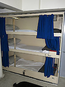 A crew bunk bed on the USS Iowa as she is docked as a museum and tourist attraction in the San Pedro Harbor on November 30, 2013 in Los Angeles, California. ©Paul Anthony Spinelli