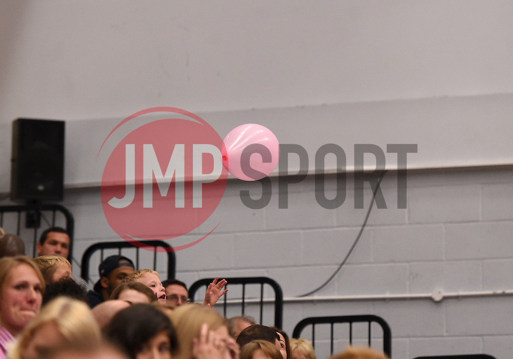 A young fan tries to catch a balloon  - Photo mandatory by-line: Joe Meredith/JMP - Mobile: 07966 386802 - 10/10/2015 - BASKETBALL - SGS Wise Arena - Bristol, England - Bristol Flyers v Newcastle Eagles - British Basketball League
