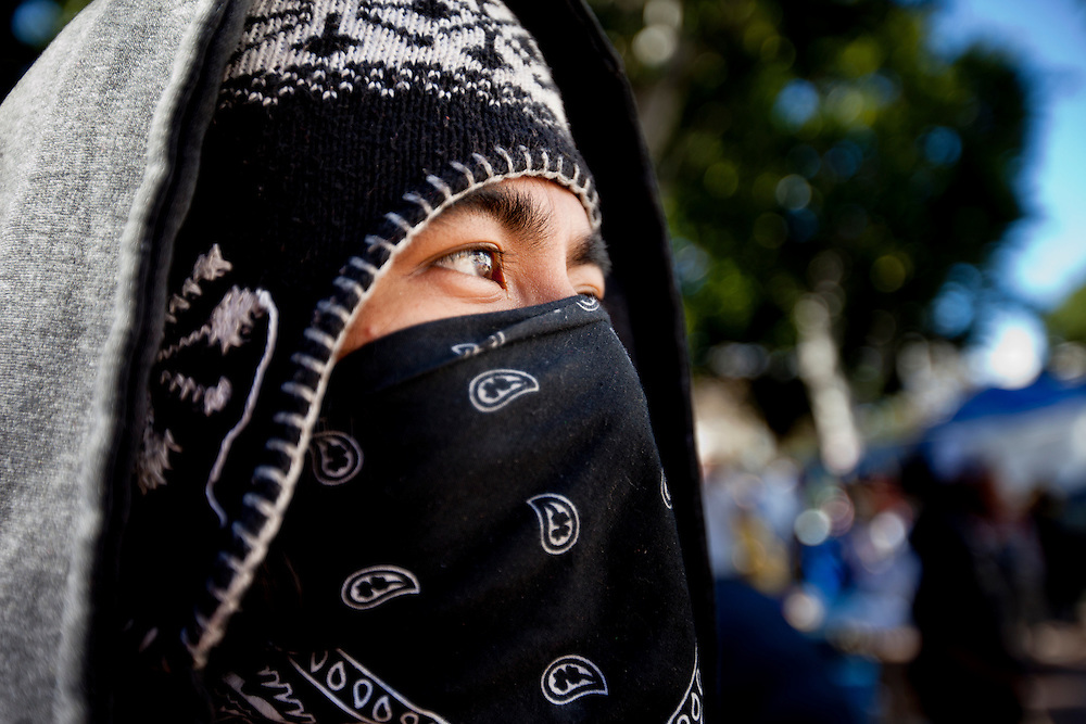 An annonymous demonstrator at Occupy LA, which took place on the grounds of city hall on Sunday, November 13, 2011 in Los Angeles, Calif. (Photo by Gabriel Romero ©2011)