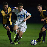 Pohang Steelers Hyojin Choi challenged by John Hutchinson during the group H group stage match between the Central Coast Mariners of Australia and Pohang Steelers of Korea in Gosford, Australia on March 11 2009, The match ended in a 0-0 draw. Photo Tim Clayton