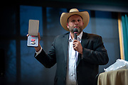 Ammon Bundy, anti-government militia leader,  holding a bronze star medal he said was given to him by a veteran during his 2016 occupation of Oregon's Malheur National Wildlife Refuge, while he was the featured speaker at the New Code of the West Conference, held at the Grouse Mountain Lodge in Whitefish, Montana, Saturday, October 13, 2018.
