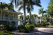 Row of luxury, stylish, winter homes with sundeck and palm trees downtown on Captiva Island in Florida, USA