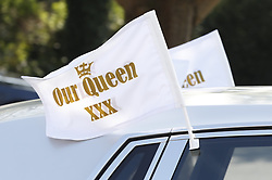 © Licensed to London News Pictures. 21/04/2018. Cobham, UK. Flags adorn  fleet of Silver Rolls Royces that make up the cortege for the funeral of traveller 'Queenie, Elizabeth Doherty at Sacred Heart Church in Cobham, Surrey. Elizabeth Doherty, whose son Paddy Doherty is known for appearing on My Big Fat Gypsy Wedding and winning Celebrity Big Brother 8, died of a heart attack earlier this month. Paddy Doherty claimed his mother has died of a 'broken heart' following the death of her husband almost a year ago. Photo credit: Peter Macdiarmid/LNP