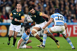 Damian de Allende of South Africa takes on the Argentina defence - Mandatory byline: Patrick Khachfe/JMP - 07966 386802 - 30/10/2015 - RUGBY UNION - The Stadium, Queen Elizabeth Olympic Park - London, England - South Africa v Argentina - Rugby World Cup 2015 Bronze Final.
