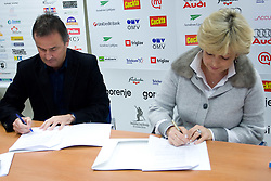Primoz Ulaga signs a contract for sponsorship with Bojana Hrovatic of Akuro at press conference, on December 22, 2008, Ljubljana, Slovenia. (Photo by Vid Ponikvar / SportIda).
