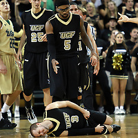 Central Florida guard Marcus Jordan (5) walks to Central Florida guard A.J. Rompza (3) after he was fouled during the NCAA basketball game against the USF Bulls at the UCF Arena on November 18, 2010 in Orlando, Florida. UCF won the game 65-59. (AP Photo/Alex Menendez)