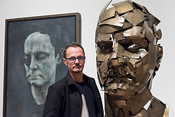 "© Licensed to London News Pictures. 07/12/2017. London, UK.  Artist Jonathan Yeo stands with his work ""Homage to Paolozzi"", 2017, created using Google's Tilt Brush virtual reality software at a preview of ""From Life"", a special exhibition at the Royal Academy examining what making art from life has meant to artists throughout history and how the practice has evolved as technology opens up new ways of creating artworks.  The exhibition runs 11 December to 11 March 2018.  Photo credit: Stephen Chung/LNP"