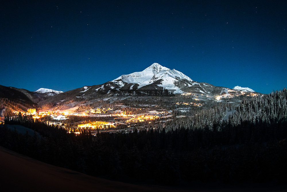 A full moon lights up Lone Peak and the Mountain Village in Big Sky, Montana.  Limited Edition - 25