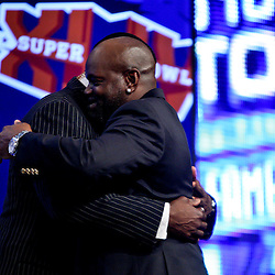06 February, 2010: Michael Irvin congratulates Emmitt Smith on stage after Emmitt Smith was announced as one of the newest Enhrinees into the Hall of Fame during a press conference for the Pro Football Hall of Fame Class of 2010 Enshrinees held at the Greater Ft. Lauderdale/Broward County Convention Center in Fort Lauderdale, Florida.