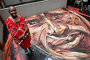 "Rooftop painting by Parisian street artist Alexandre Monteiro aka Hopare of Masai warrior Daniel Ole Sambu (Pictured)<br /> Street art in Hong Kong ahead of the The ""Hope for Wildlife"" Gala Dinner painted to raise awareness for the plight of endangered animals the world over.<br /> Sheung Wan Hong Kong<br /> 10th November 2016. Photo by Jayne Russell"