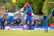 Afghan player Hashmatullah Shaidi plays a shot during the One Day International match between Scotland and Afghanistan at The Grange Cricket Club, Edinburgh, Scotland on 10 May 2019.
