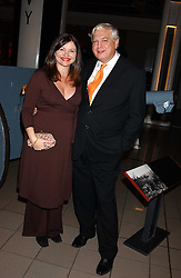 JOHN SIMPSON and his wife ADELE at the opening of the exhibition 'Lawrence of Arabia: The Life, The Legend' at the Imperial War Museum, Lambeth Road, London SE1 on 11th October 2005.<br /><br />NON EXCLUSIVE - WORLD RIGHTS