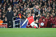 Arsenal midfielder Alex Oxlade-Chamberlain (15) tackling Bayern Munich attacker Frank Ribery (7) during the Champions League round of 16, game 2 match between Arsenal and Bayern Munich at the Emirates Stadium, London, England on 7 March 2017. Photo by Matthew Redman.