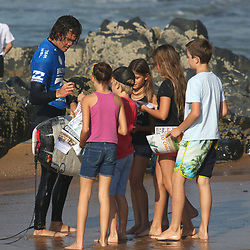 Jordy Smith of South Africa with some fans during the The Ballito Pro at Willard Beach, Ballito, South Africa. (Photo Brian Spurr)