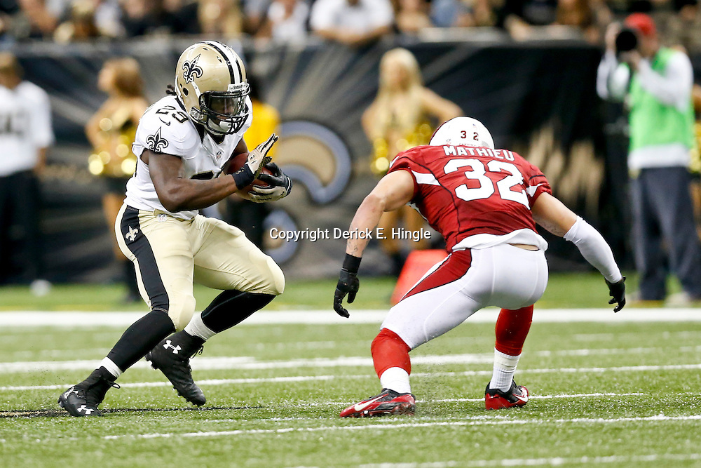 Sep 22, 2013; New Orleans, LA, USA; New Orleans Saints running back Khiry Robinson (29) against Arizona Cardinals defensive back Tyrann Mathieu (32) during a game at Mercedes-Benz Superdome. The Saints defeated the Cardinals 31-7. Mandatory Credit: Derick E. Hingle-USA TODAY Sports