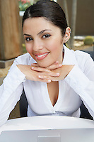 Young business woman smiling, portrait