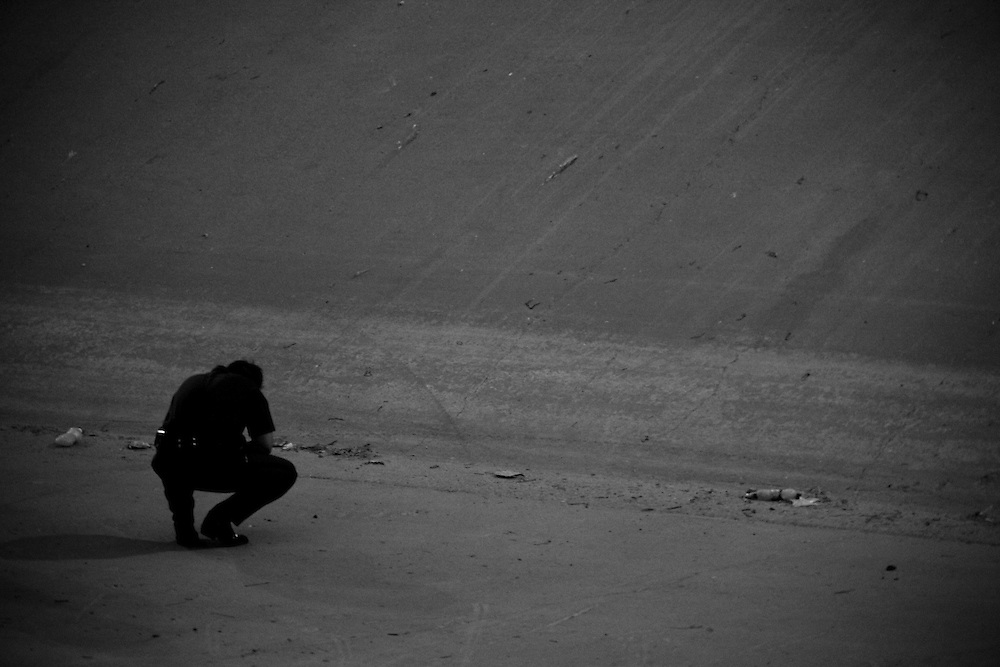 A U.S. Border Patrol agent investigates on the U.S. side of the scene of the shooting of a 15 year-old boy, who was killed by a U.S. Border Patrol agent in Ciudad Juarez, Chihuahua on June 7, 2010 after he had tried to cross into the United States.
