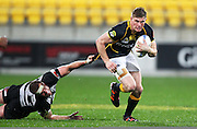 Lions' Jason Woodward on the attack as Hawke's Bay's Michael Coman attempts to hold him back during the 2012 ITM Cup rugby session - Wellington Lions v Hawke's Bay at Westpac Stadium, Wellington, New Zealand on Tuesday 28 August 2012. Photo: Justin Arthur / photosport.co.nz