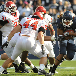Oct 31, 2009; East Hartford, CT, USA; Connecticut running back Andre Dixon (2) runs the ball during first half Big East NCAA football action between Rutgers and Connecticut at Rentschler Field/