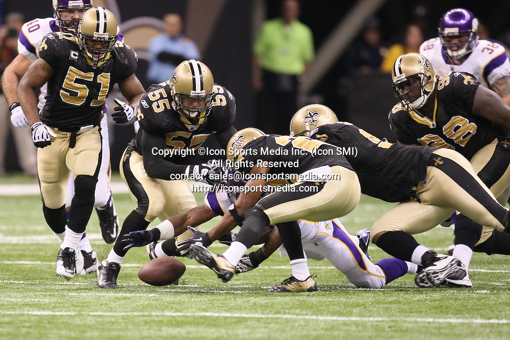 24 January 2010: Minnesota Vikings running back Adrian Peterson (28) recovers his own fumble.  The New Orleans Saints defeated the Minnesota Vikings by a score of 31 to 28 at the Louisiana Superdome, New Orleans, LA.