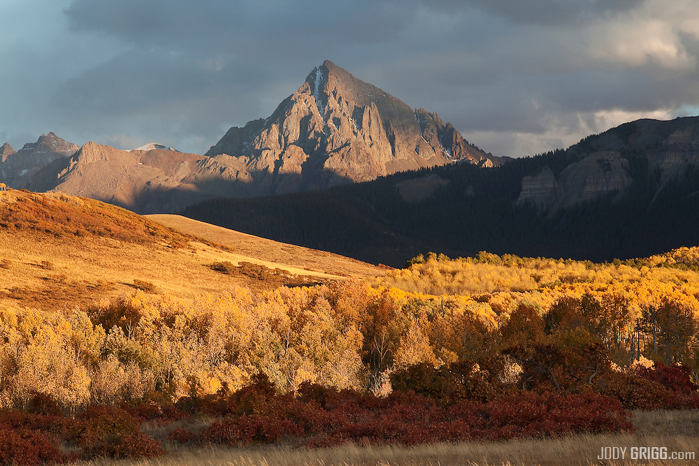 Sunset light shines thru storms clouds onto Mount Sneffels 14,150ft, Colorado.