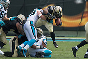 Luke Kuechly(59) stops Mark Ingram(22) in the New Orleans Saints 34 to 13 victory over the Carolina Panthers.