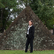 "August 20, 2012 - Purchase, NY : Paola Morsiani, the recently appointed director of the Neuberger Museum of Art at SUNY Purchase, poses for a portrait in front of Jackie Ferrara's 'A 120 Stacked Pyramid, 1973' (Wood, 104.5"" x 164"" x 47"", collection Neuberger Museum of Art). CREDIT: Karsten Moran for The New York Times"