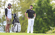 Oliver FARR eying his second shot on the 1st hole during the 4th day of the BMW PGA Championship at Wentworth, Virginia Water, United Kingdom on 24 May 2015. Photo by Ellie  Hoad.