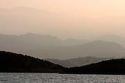 The Sea Cloud leaves Agios Nikolaos at sunset.
