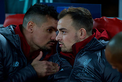 LIVERPOOL, ENGLAND - Tuesday, December 11, 2018: Liverpool's substitutes Dejan Lovren (L) and Xherdan Shaqiri during the UEFA Champions League Group C match between Liverpool FC and SSC Napoli at Anfield. (Pic by David Rawcliffe/Propaganda)