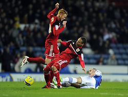 Blackburn Rovers' Danny Murphy tackles Bristol City's Bobby Reid and Bristol City's Ryan Taylor - Photo mandatory by-line: Joe Meredith/JMP  - Tel: Mobile:07966 386802 05/01/2013 - Blackburn Rovers v Bristol City - SPORT - FOOTBALL - FA Cup -  BLACKBURN - EWOOD PARK -
