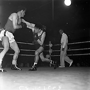 26/01/1962<br /> 01/26/1962<br /> 26 January 1962<br /> Irish Amateur National Junior Boxing Championships at the National Stadium, Dublin. J. O'Leary (right) Fr Hogan's Boxing Club, Cork, lands a straight right to the body of S. Aspell, Kilcullen Boxing Club, during their Welterweight semi-final that Aspell won.