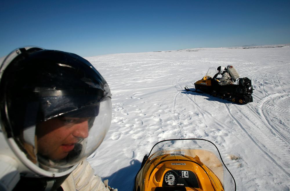 Simon Auclair -24 (in the front of the image) Melissa Battler -26 driving snowmobile on the way to a mission out from The FMARS (Flashline Mars Arctic Research Station) laboratory,..On Devon Island Canada....Mars flashline Mars arctic (FMARS)....On Devon Island in the high Canadian Arctic a group of sciences from the USA & Canada is gathering for four month to search watt human being can do on mars planet...The four month mission will be the first time that a simulated Mars mission has ever been conducted for such a long duration...The crow of volunteers includes some biologist geologist and other nether scientist researches.....They chose Devon Island in Canada because it simulated the acclaim on the planet Mars, for getting the filling of being on Mars and to challenge the research and to make it close as they can to the conditions on the planet they wear spies suit and live isolated in the laboratory for four month...The man person that ran the project is Dr Robert Zabrin that believe that this project can lied to find ways to search for life on Mars and maybe to fined a way that human being will be able to live on the planet.....This project is privet projects that cooperate with several universities around the world.....