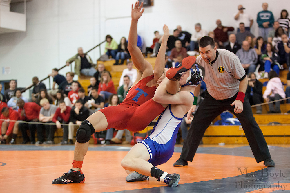 Ceaser Dash of Triton Regional High School vs. Mike Graham of Williamstown High School during the District 30 Wrestling 138 lbs weight class Semi-final at Overbrook High School on February 18, 2012. (photo / Mat Boyle)